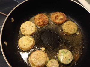 Fried green tomatoes frying in pan fried green tomato recipe