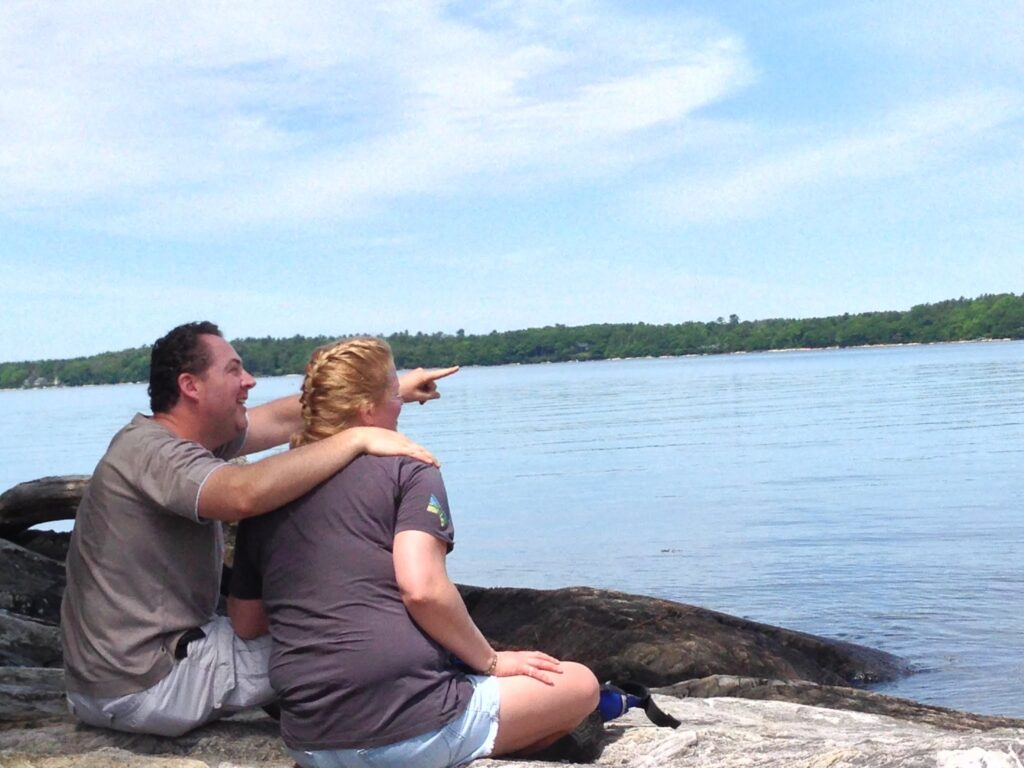 Bill Walsh and Christina Gammon admiring Casco Bay