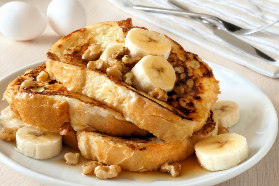French toast with bananas, walnuts and dripping maple syrup