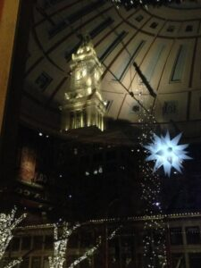 Faneuil Hall view of Government Center and reflection of Faneuil Hall ceiling and holiday light display