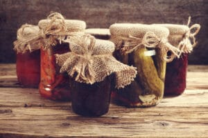 Mason jars with burlap and twine on the tops